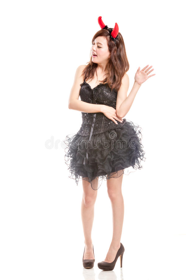 Chinese woman in black dress and devil horns royalty free stock photo