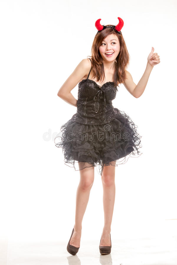 Chinese woman in black dress and devil horns with stock images