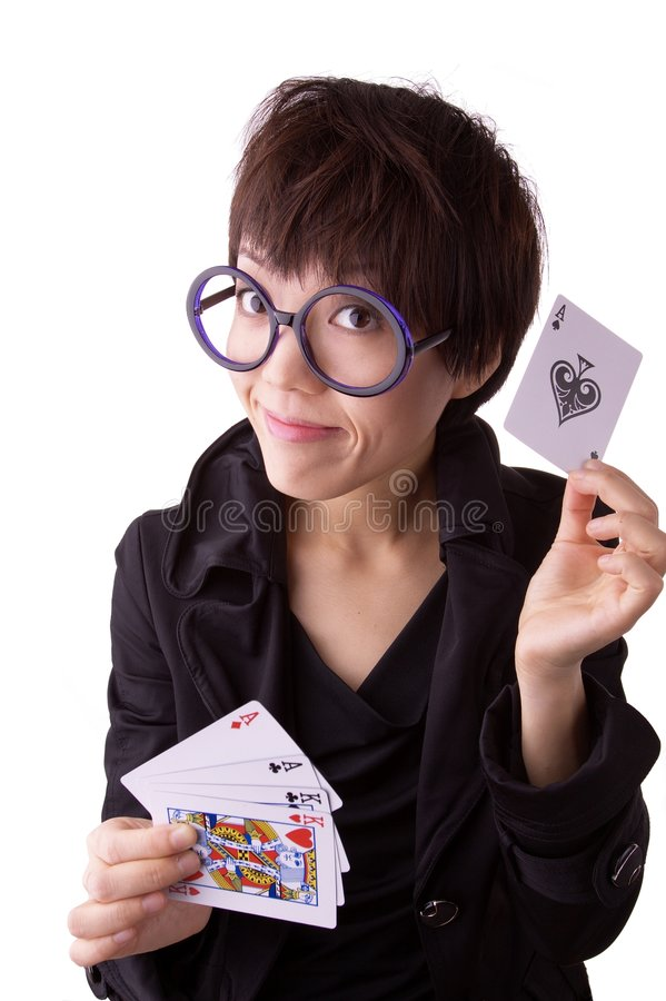 Chinese Woman With Cards. Young Chinese woman with large, round glasses, holding four cards in one hand, and holding up an Ace of Spades in the other, completing royalty free stock image