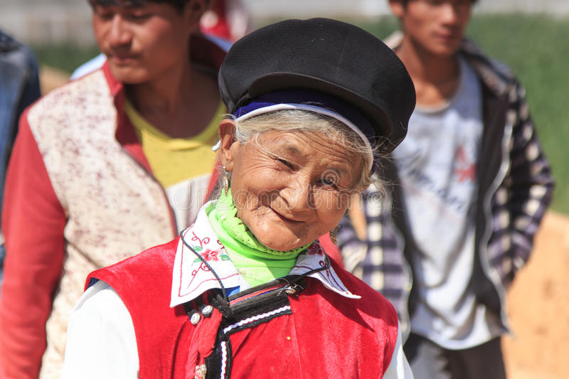Chinese woman dressed with traditional Bai clothing during the Heqing Qifeng Pear Flower festival. Heqing, China - March 15, 2016: Chinese woman dressed with royalty free stock image