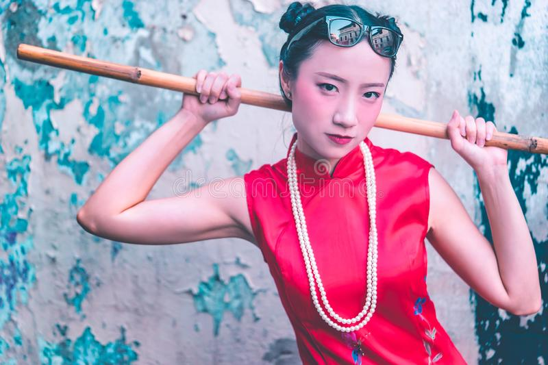 Chinese woman is getting ready to clean up male dirty toilet. Young chinese woman is getting ready to clean up male dirty toilet royalty free stock photography