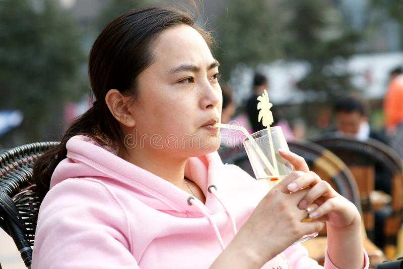 Chinese woman having a drink. Was taken in chongqing of china,a chinese woman having a drink,2010 spring stock photos