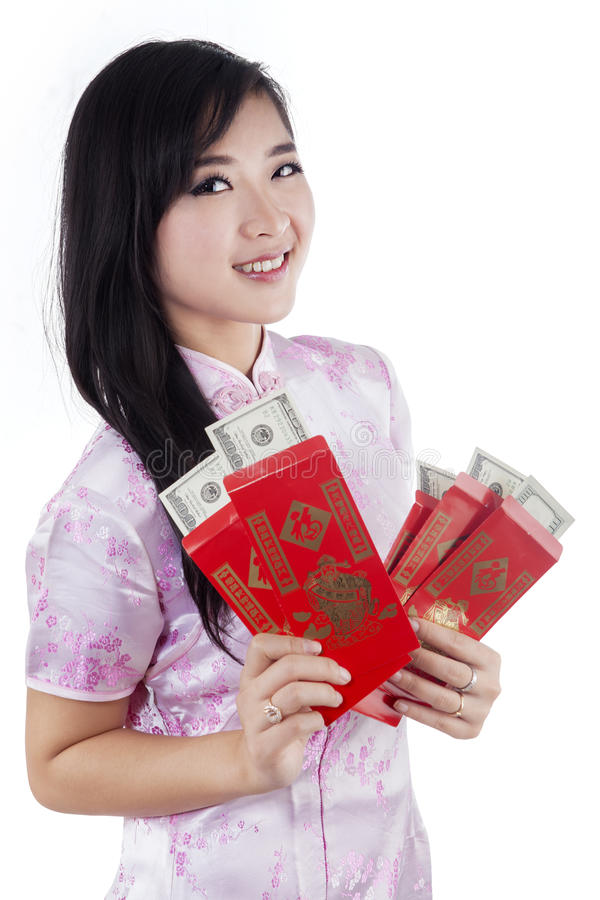 Chinese woman with money in envelope royalty free stock photography