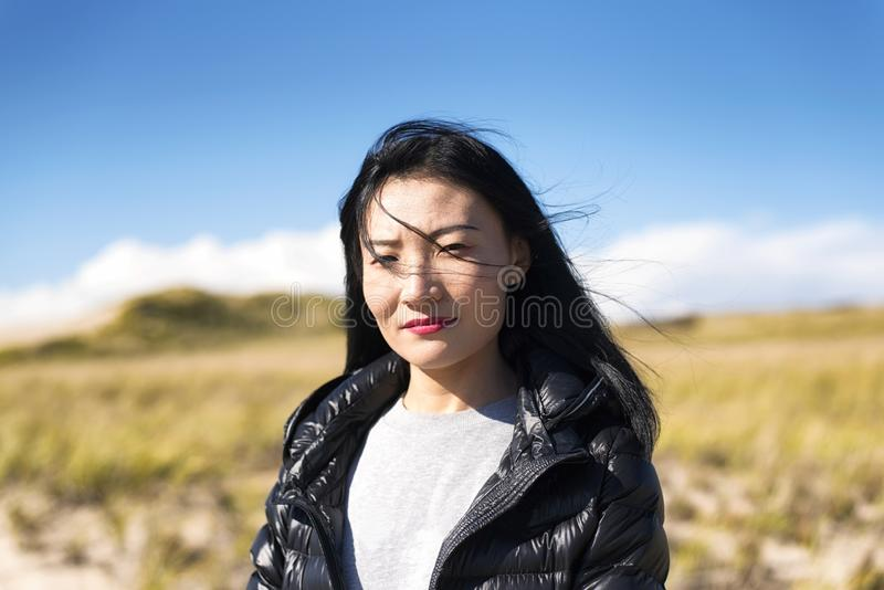 Cape Cod National Seashore Nature woman. A chinese woman outside on a sunny windy day on the cape cod national seashore in Truro Massachusetts royalty free stock image