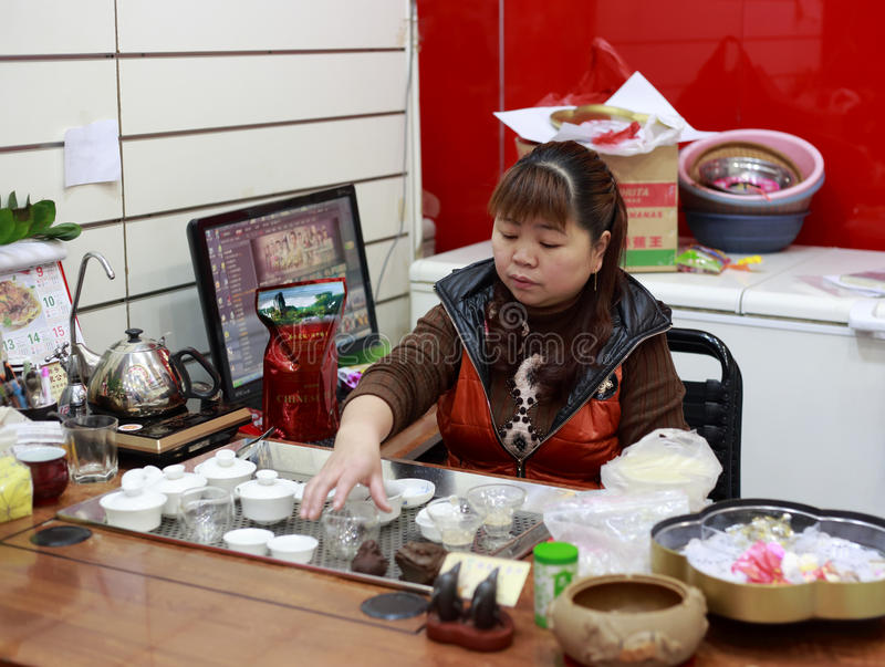 Chinese woman performing the tea ceremony