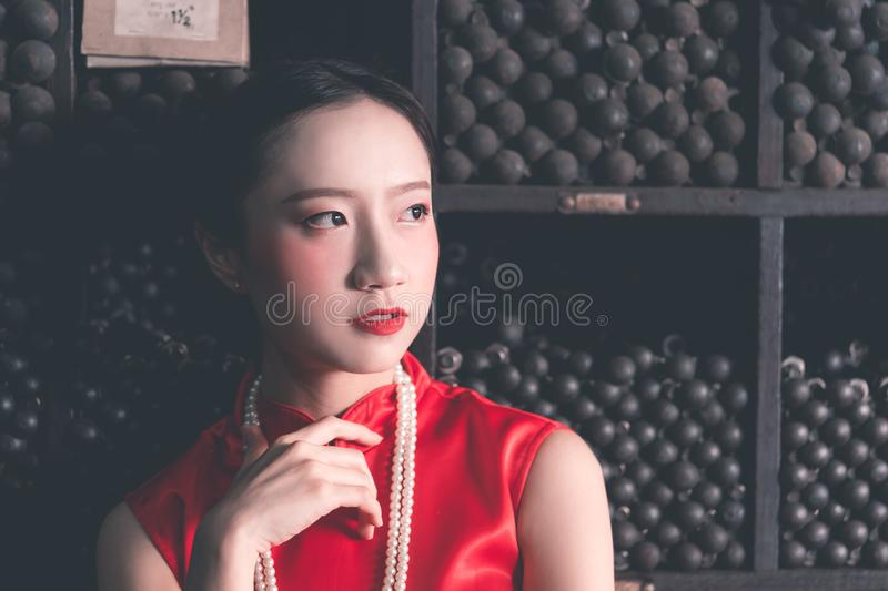 Chinese woman in a steel metal rod store royalty free stock images