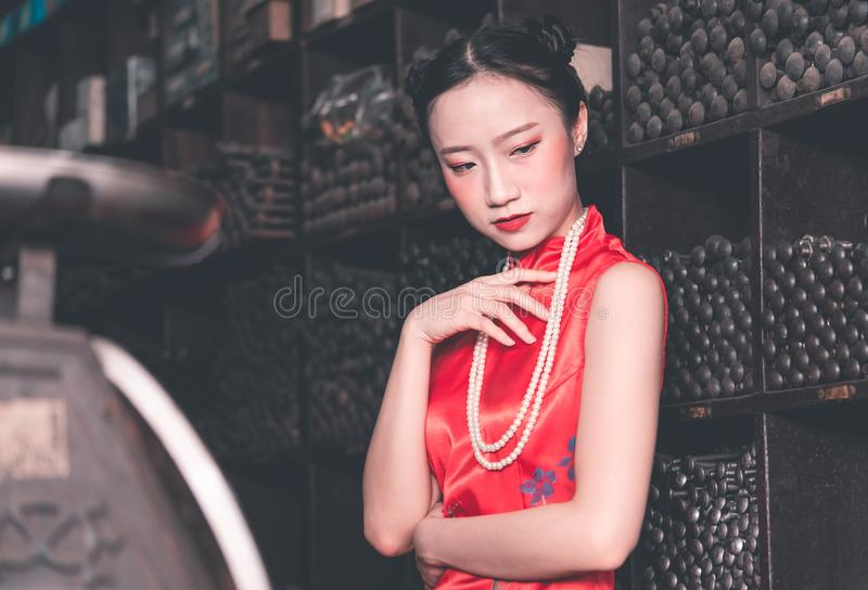 Chinese woman in steel metal rod industrial store royalty free stock images