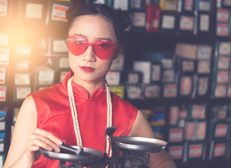 Chinese woman in a steel rod industrial store royalty free stock photo