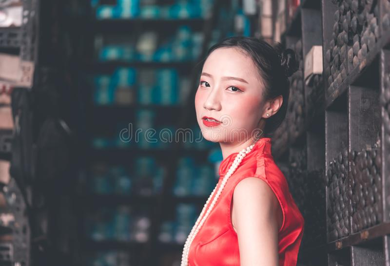 Chinese woman in steel metal rod industrial store stock images