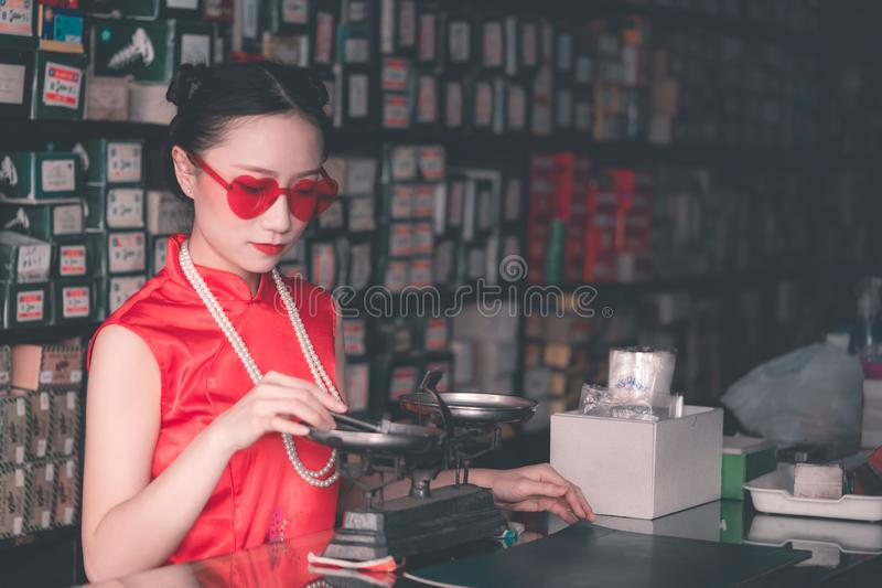 Woman in a steel metal rod industrial store royalty free stock photos