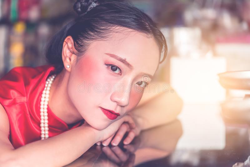 Chinese woman in steel metal rod industrial store stock photo