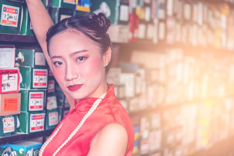 Chinese woman in steel metal rod industrial store royalty free stock image