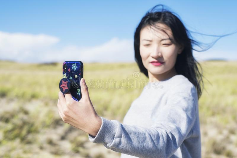 Cape Cod National Seashore Nature woman selfie. A chinese woman taking a selfie on a sunny windy day on the cape cod national seashore in Truro Massachusetts royalty free stock photography