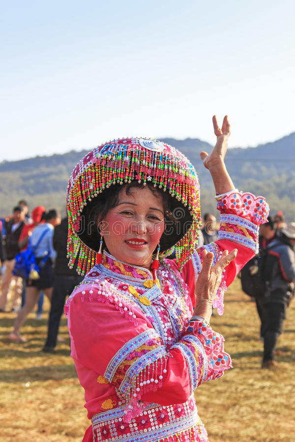 Chinese woman in traditional Miao attire during the Heqing Qifeng Pear Flower festival. Heqing, China - March 15, 2016: Chinese woman in traditional Miao attire stock photo