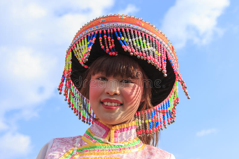 Chinese woman in traditional Miao attire during the Heqing Qifeng Pear Flower festival. Heqing, China - March 15, 2016: Chinese woman in traditional Miao attire royalty free stock photo