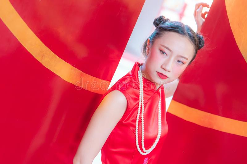 Chinese woman wearing cheongsam for chinese new year concept stock photography