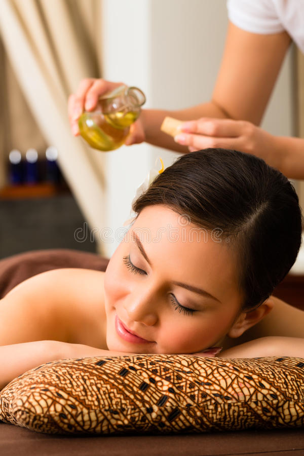 Chinese Woman at wellness massage with essential oils stock photo