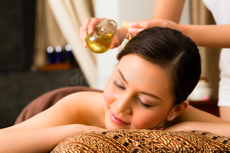 Chinese Woman at wellness massage with essential oils royalty free stock photography
