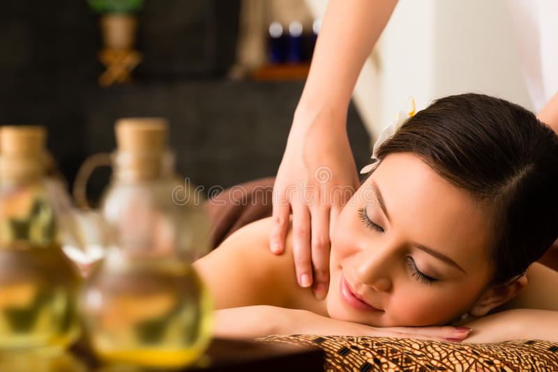 Chinese Woman at wellness massage with essential oils stock photos