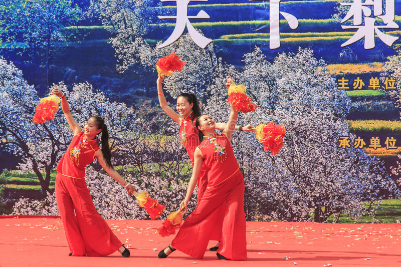 Chinese women dressed with traditional clothing dancing and singing during the Heqing Qifeng Pear Flower festival royalty free stock photo
