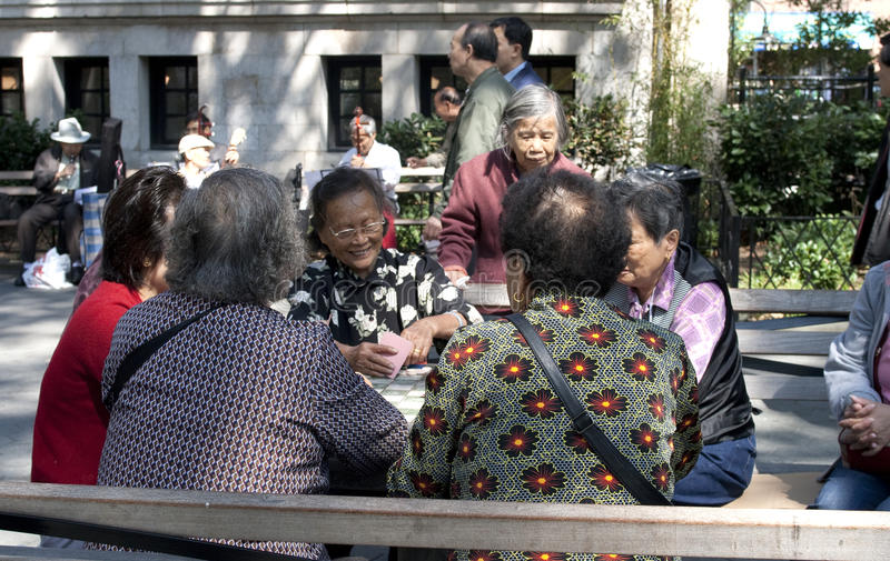 Chinese women playing cards stock images