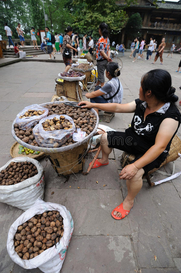 Chinese Women Selling Walnuts Editorial Stock Image