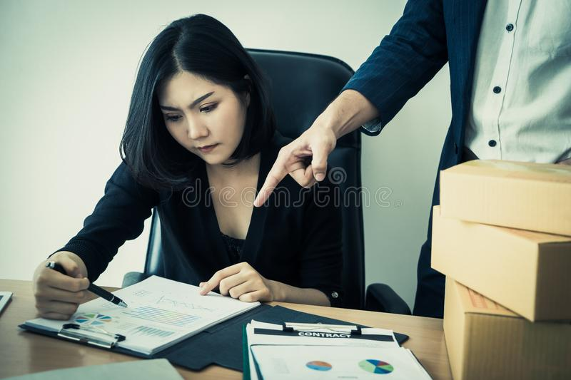 Chinese woman working with angry boss blaming stock photos