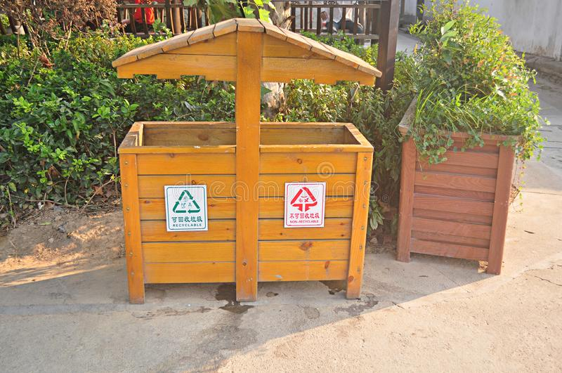 Chinese wood waste bin, recyclable bin, non-recyclable bin. Chinese wood garbage bin, recyclable garbage bin, non-recyclable garbage bin, this is a fashion royalty free stock photos