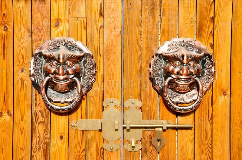 Chinese Wooden Door with copper knocker royalty free stock image