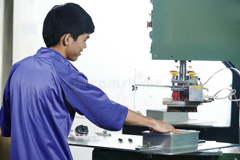 Chinese worker operating press royalty free stock photos