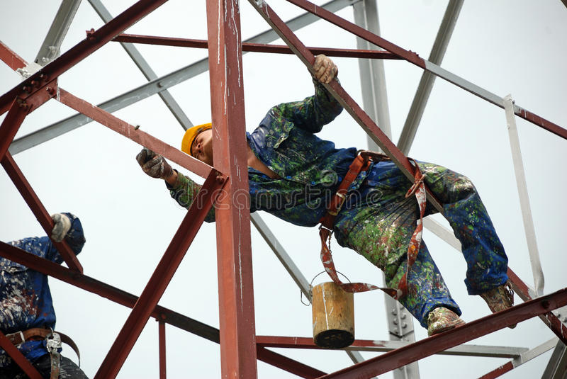 Chinese worker painting steel structure stock image