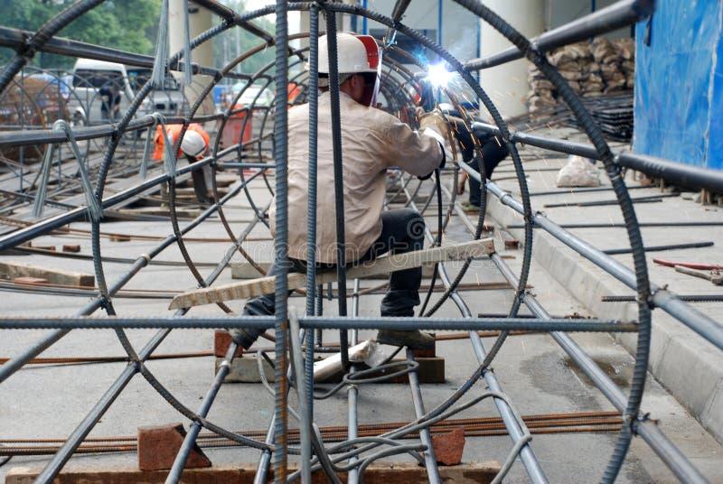 Chinese worker welding steel stock image