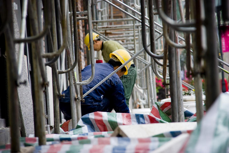 Chinese workers in scaffolding royalty free stock photo