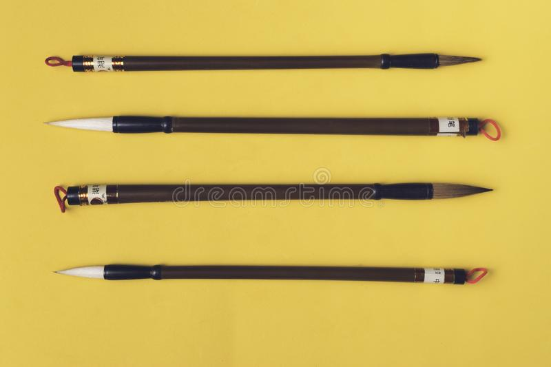 Chinese writing brushes Mao Pi. On a yellow background stock photo