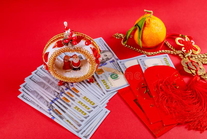 Chinese yin and yang talisman on red Ang Pau money packet, chinese new year decorations, tangerines and U.S dollar money stock image