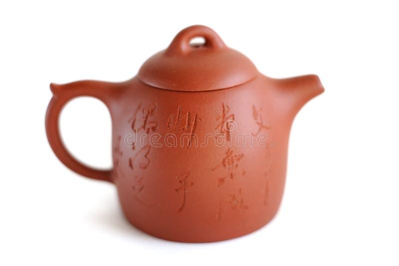 Chinese Yixing clay tea pot Wen Zhang Ben Tian Cheng, Miao Shou. Chinese Yixing clay tea pot with inscription: Wen Zhang Ben Tian Cheng, Miao Shou Ou De Zhi (get stock image
