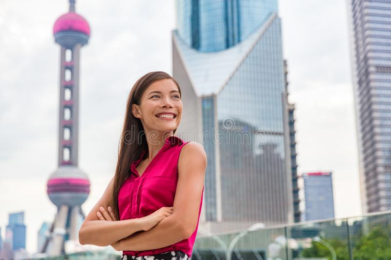 Chinese young woman portrait in Shanghai, China. Travel in Asia. Multiracial Asian Caucasian businesswoman smiling happy with stock image