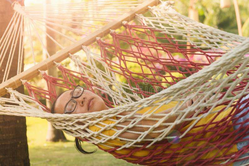 Chinese young woman sleeping on hammock stock images
