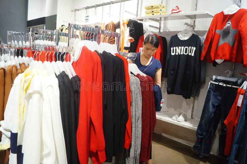 Chinese young women purchase clothing stock photography