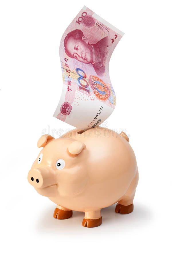 Chinese China Yuan Money Piggybank. A Chinese one hundred renminbi yuan note going into a piggybank on a white background royalty free stock photos