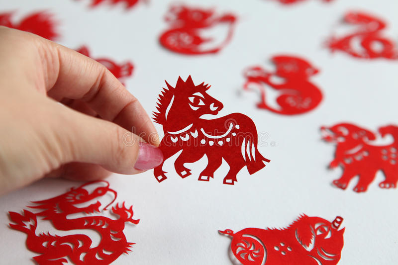 Chinese zodiac papercutting, Year of Horse. Chinese Paper Cuts have been a traditional form of decoration in China at Chinese New Year and all year round for stock photo