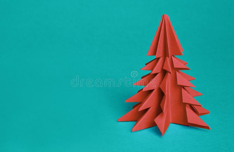 Chinese Zodiac Sign Year of Pig. green origami paper tree and white pig symbol of 2019, on a red background, free space. For text, minimalism. Happy New Year royalty free stock photography