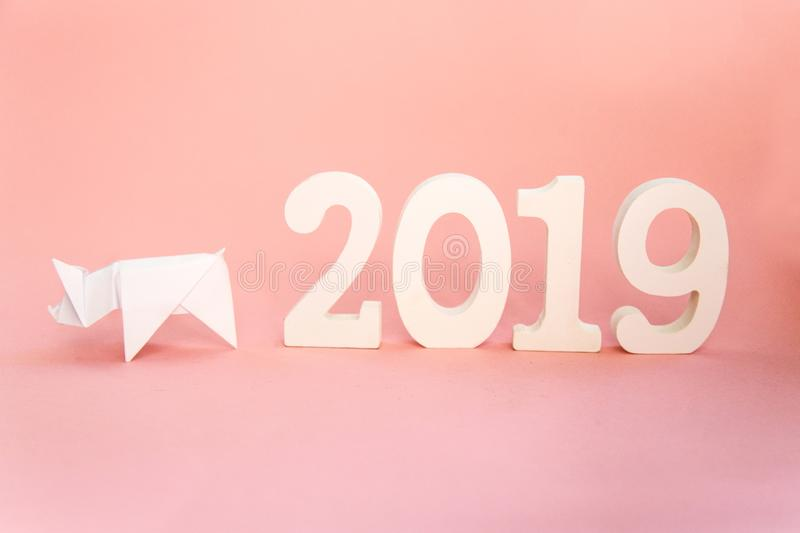 Chinese Zodiac Sign Year of Pig, White paper cut pig origami, Happy New Year 2019 year. Free space for text. Minimalism gradient. Chinese Zodiac Sign Year of Pig stock photos