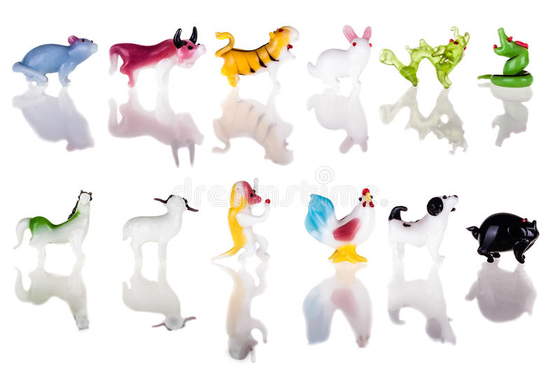 Chinese zodiac. Small glass sculptures representing the chinese zodiac signs isolated over a pure white background royalty free stock photography