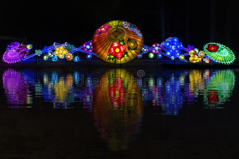 Chineses illumination. Reflection in the dark night stock images