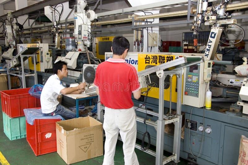 Chinesische Borduhrfabrik stockfotos