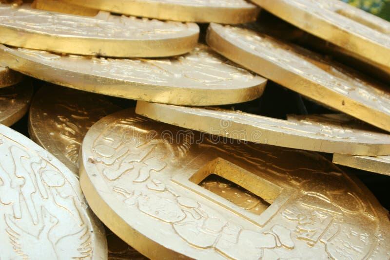 Chinesische Goldmünzen stockbilder