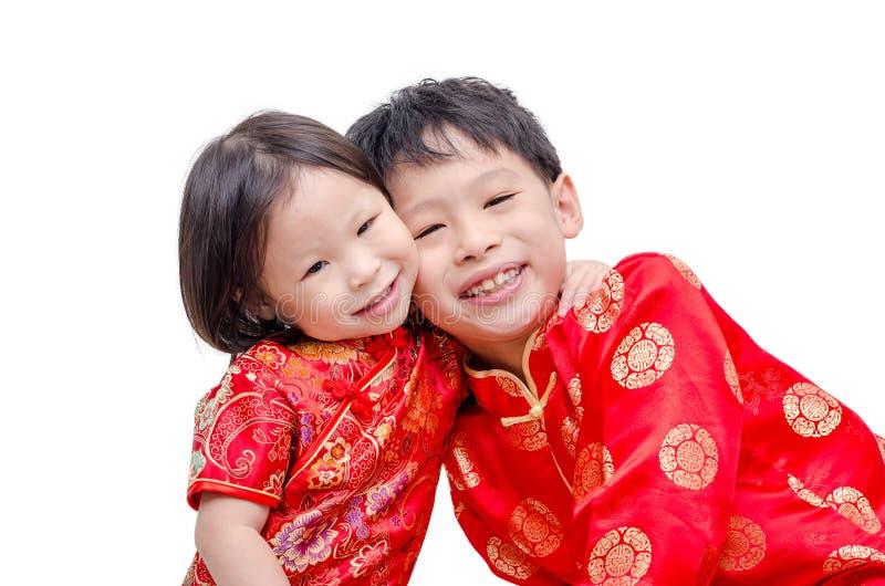 Chinesische Kinder im traditionellen Kostüm lizenzfreie stockbilder