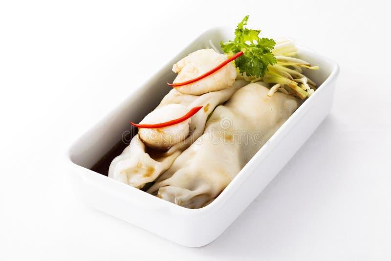 Chinesische Reisrolle der Tradition mit Kamm-Muscheln stockfoto