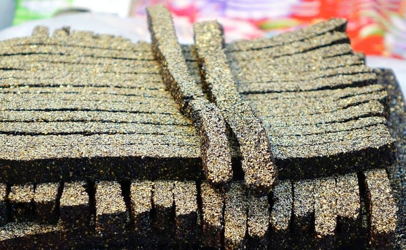 Chinesische schwarze Süßigkeit des indischen Sesams stockfotos